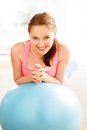 Portrait of attractive young woman relaxing  fitness ball at gym Royalty Free Stock Photo