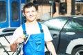 Portrait of auto mechanic worker with power polisher machine Royalty Free Stock Photo