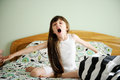 Portrait of awaken little girl sitting in bed Royalty Free Stock Photography