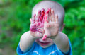 Portrait baby face dirty from blueberries Royalty Free Stock Photo