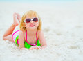 Portrait of baby girl in sunglasses on beach Royalty Free Stock Photo