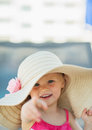 Portrait of baby in hat pointing in camera Royalty Free Stock Photography