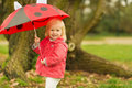 Portrait of baby with red umbrella outdoors Royalty Free Stock Photo