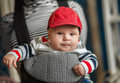 Portrait of a baby sitting in an ergonomic baby carrier cute Stock Images