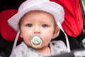 Portrait of a baby with sun hat and pacifier Royalty Free Stock Photo