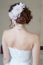 Portrait of back of bride in white dress with hair style and flo Royalty Free Stock Photo