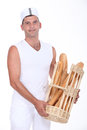 Portrait of a baker holding fresh bread Stock Image