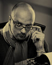 Portrait of a bald serious man in glasses Stock Photo