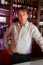 Portrait Of Barman Standing Behind Bar Stock Image