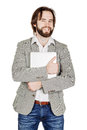 Portrait of bearded business man standing with laptop and looking at camera Royalty Free Stock Photo