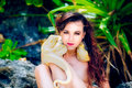 Portrait of the beatiful girl with dangerous snake in the tropic Royalty Free Stock Photo