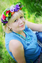 Portrait of a beautiful adult woman with flower wreath Royalty Free Stock Photos