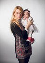 Portrait of beautiful aged woman holding baby gir studio women girl Stock Photo
