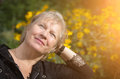 Portrait of beautiful aged woman in the park selective soft focus on eyes Royalty Free Stock Image