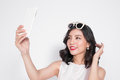 Portrait of beautiful asian fashionable girl taking selfie Royalty Free Stock Photo