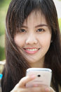 Portrait beautiful asian girl play smart phone in studio Royalty Free Stock Photos