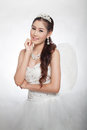 Portrait beautiful asian woman in white wedding dress with fairy scepter with angel wings smiling studio light background Stock Images