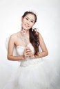 Portrait beautiful asian woman in white wedding dress with fairy scepter with angel wings smiling studio light background Royalty Free Stock Image
