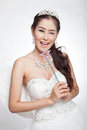 Portrait beautiful asian woman in white wedding dress with fairy scepter with angel wings smiling studio light background Stock Photography