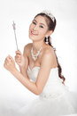 Portrait beautiful asian woman in white wedding dress with fairy scepter with angel wings smiling studio light background Royalty Free Stock Photos