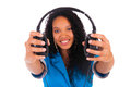 Portrait of a beautiful black woman with headphones listening to