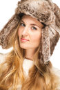 Portrait of the beautiful blond girl fur hat Stock Photo