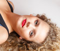 Portrait beautiful blond girl make up lying on floor studio shot Stock Photography