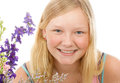 Portrait of beautiful blond teenage girl a blue eyed with flowers on a white background Royalty Free Stock Images