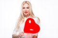 Portrait of beautiful blond woman with bright makeup and red heart in hand valentines day love holding hearts smiling cute Royalty Free Stock Image