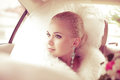 Portrait of beautiful blonde bride sitting in the wedding car Royalty Free Stock Photo