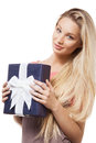 Portrait beautiful blonde girl holding blue gift box looking camera Royalty Free Stock Photography
