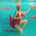 Portrait of beautiful blonde woman with pink flamingo