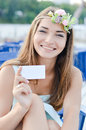 Portrait of beautiful blonde young woman having fun happy smiling and holding blank copy space business card picture looking at Royalty Free Stock Photos