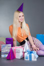 Portrait of beautiful blondie girl with gift Stock Images