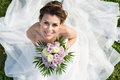 Portrait of beautiful bride high view happy sitting on the grass Royalty Free Stock Photo