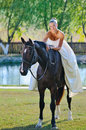 Portrait of beautiful bride with horse Royalty Free Stock Photography
