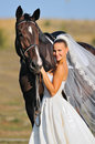 Portrait of beautiful bride with horse Royalty Free Stock Photo