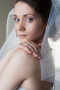 Portrait of beautiful bride woman with veil white and hand on shoulder Stock Photo