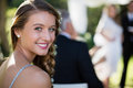 Portrait of beautiful bridesmaid smiling in park Royalty Free Stock Photo