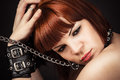 Portrait of beautiful brown haired woman in handcuffs Stock Photo