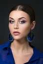 Portrait of beautiful brunet woman with fashion make up and blue earrings Stock Photo