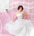 Portrait of beautiful brunette bride on pink Royalty Free Stock Image