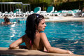Portrait of a beautiful brunette girl in pool Royalty Free Stock Image