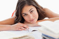 Portrait of a beautiful brunette head on her homeworks Royalty Free Stock Photos