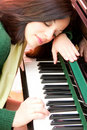 Portrait of a beautiful brunette and her piano Stock Image