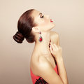 Portrait of beautiful brunette woman with earring perfect makeu makeup fashion photo Stock Photo