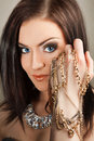 Portrait of beautiful brunette woman in jewellery Royalty Free Stock Image