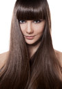 Portrait of a beautiful brunette woman with long straight hair on white Royalty Free Stock Images