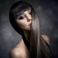 Portrait of a beautiful brunette woman with long straight hair young Stock Image