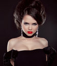 Portrait beautiful brunette woman red lips over dark studio photo Stock Photography